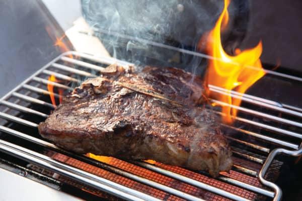 Prestige pro665 3 detail infrared side burner steak with flames scaled image on safe home fireplace website