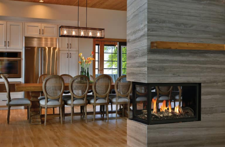 Marquis atrium peninsula gas fireplace with driftwood log set