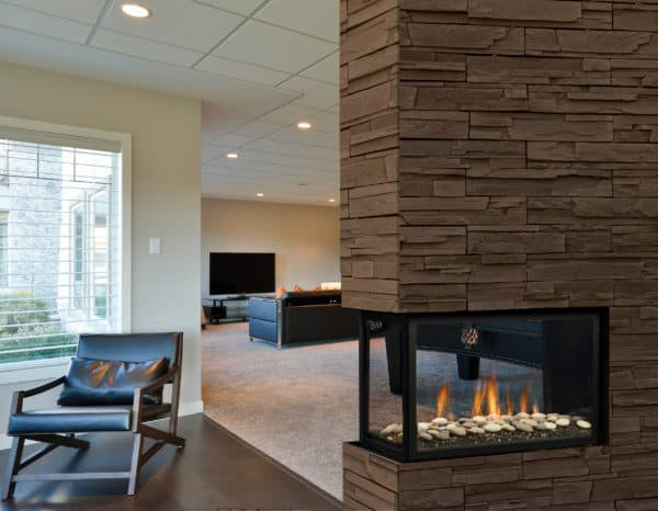 Marquis atrium peninsula gas fireplace with river rock media