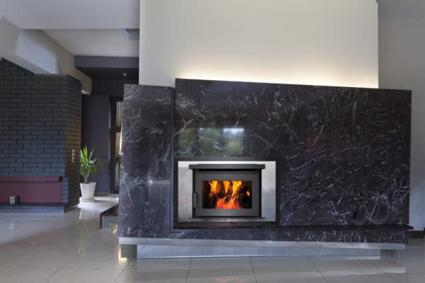 Pacific energy fp25 wood fireplace with marble surround
