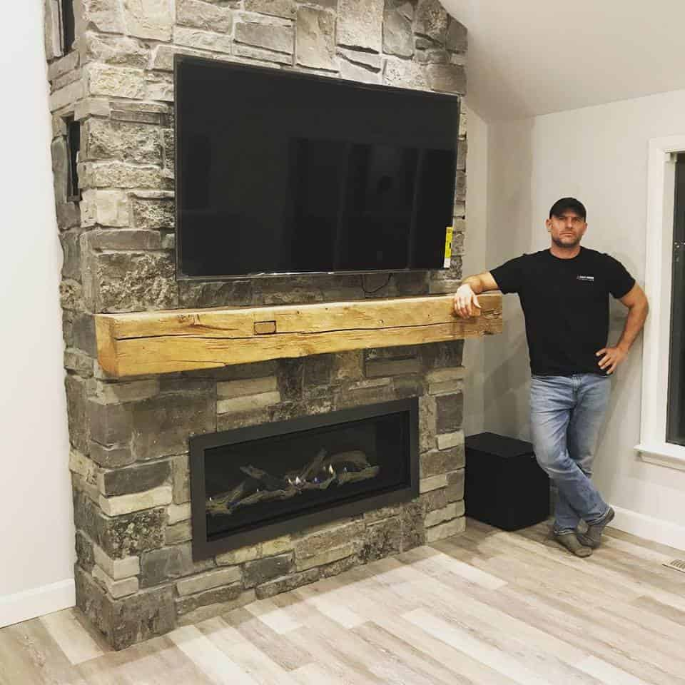 Enviro C44 with Natural Stone Veneer Wall and Beam Mantel