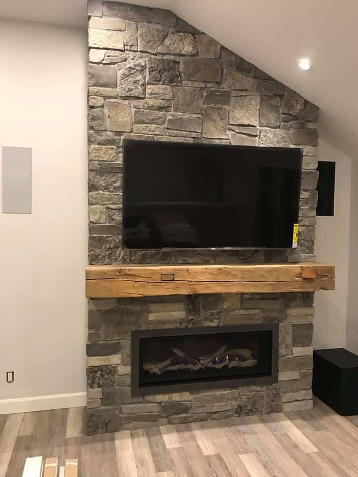 Enviro C44 Linear Fireplace with Driftwood, Natural Stone Veneer wall with TV Mounted and Rustic Beam Mantel
