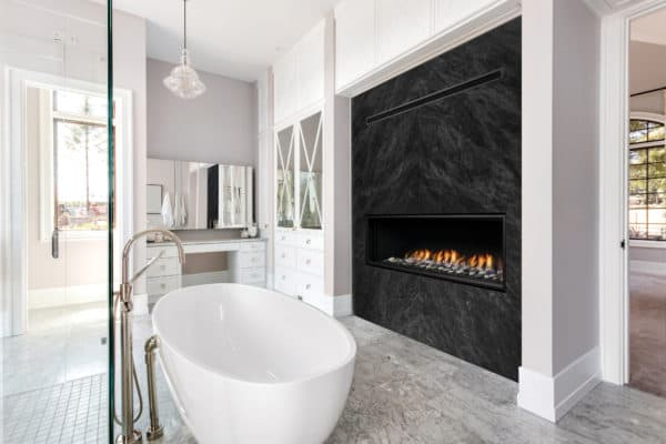 """Marquis serene 47"""" linear gas fireplace in bathroom with marble wall"""