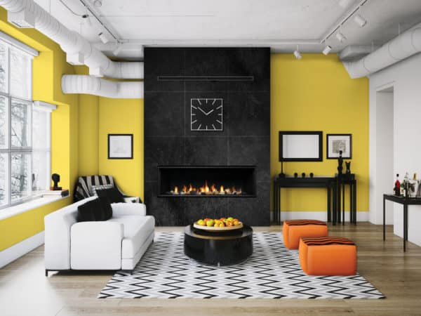 """Marquis Serene 47"""" Linear Gas Fireplace with yellow wall and black surround"""
